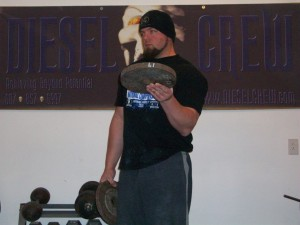 A man with Plate curling.