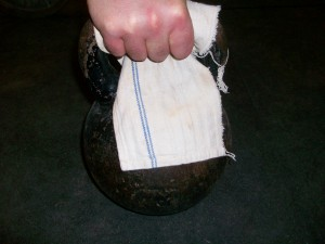 gripping kettlebell handle with towel wrapped on